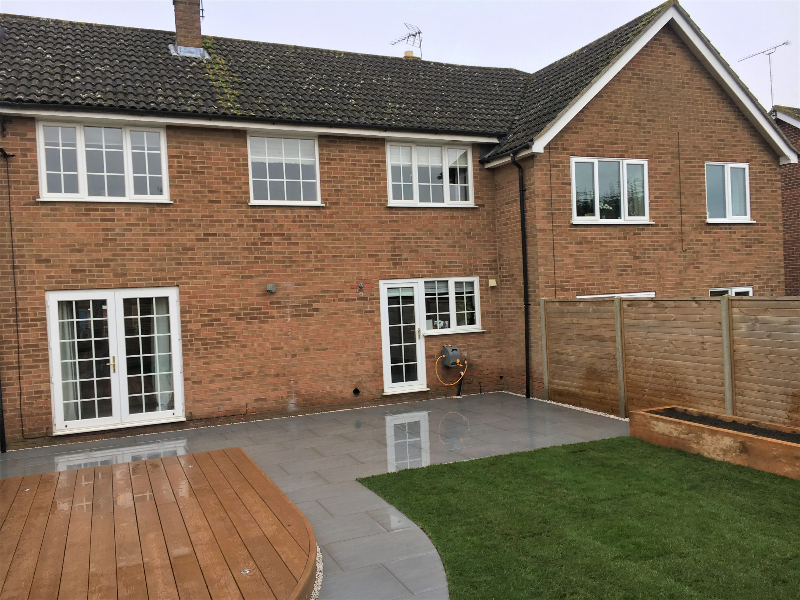 Porcelain patio & Millboard decking completed with new lawn and flower beds