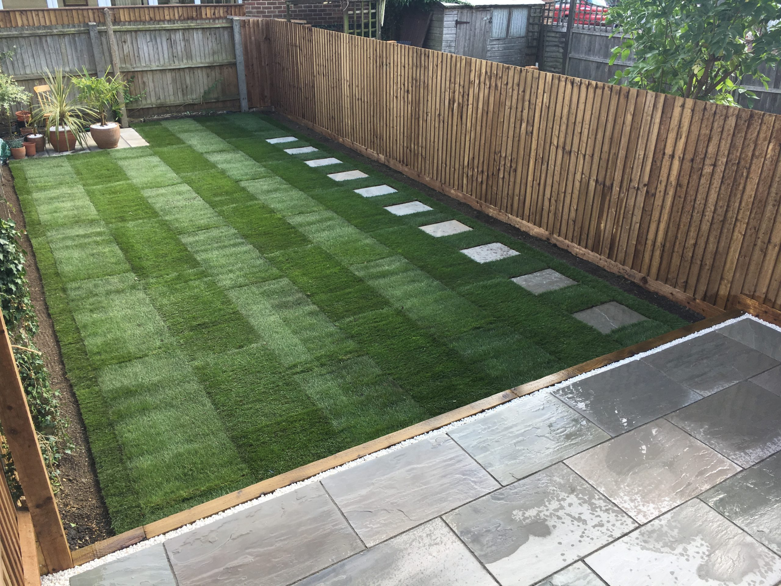 Tiered Garden with natural stone paving and lawn - Cambirdge Project